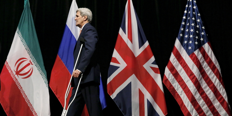 U.S. Secretary of State John Kerry leaves the stage at the Vienna International Center in Vienna, Austria on July 14, 2015 during talks in which Iran and six major world powers reached a nuclear deal.