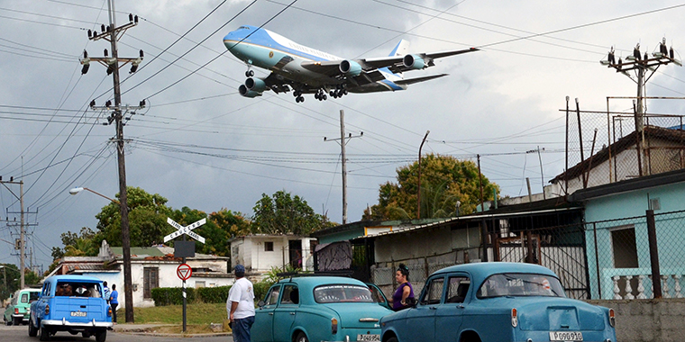 Air Force One carrying U.S. President Barack Obama and his family flies over a neighborhood of Havana as it approaches the runway to land at the city's international airport, on March 20, 2016.