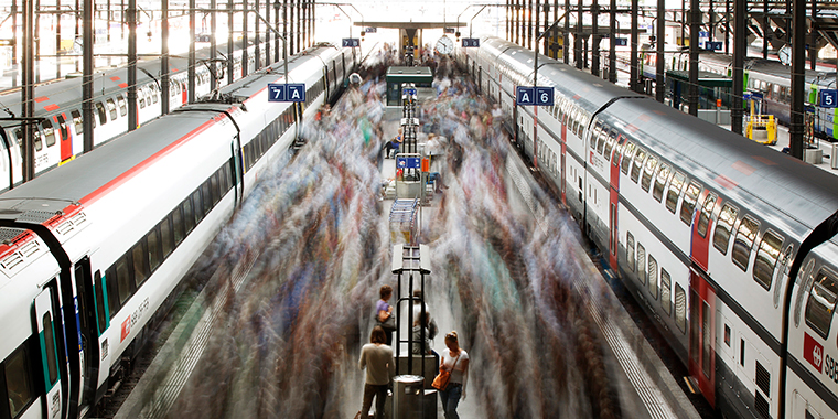 A long exposure picture shows commuters walking on a Swiss Federal Railways platform at the main station in Lucerne, on August 7, 2012.