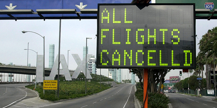 A sign flashes that all flights are cancelled at the Los Angeles International Airport on September 11, 2001.