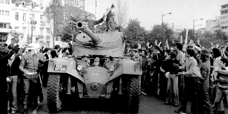 Soldiers in a tank drive through Lisbon during the military coup on April 25, 1974. That year, Portugal withdrew from its African colonies, including Mozambique and Angola.