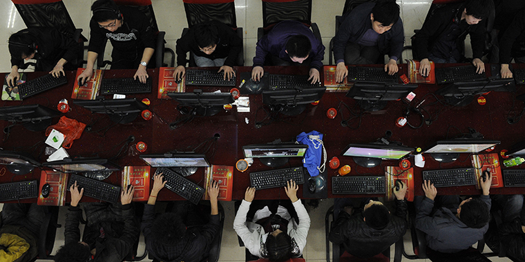 People use the computer at an Internet cafe in Taiyuan in the Shanxi province of China on March 31, 2010.
