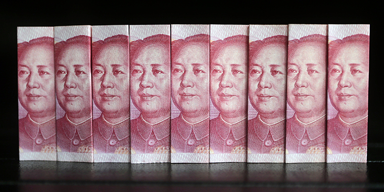Chinese 100 yuan banknotes in Beijing on July 11, 2013. Investments from China usually come from state-owned companies and companies with close ties to the Chinese Communist Party.