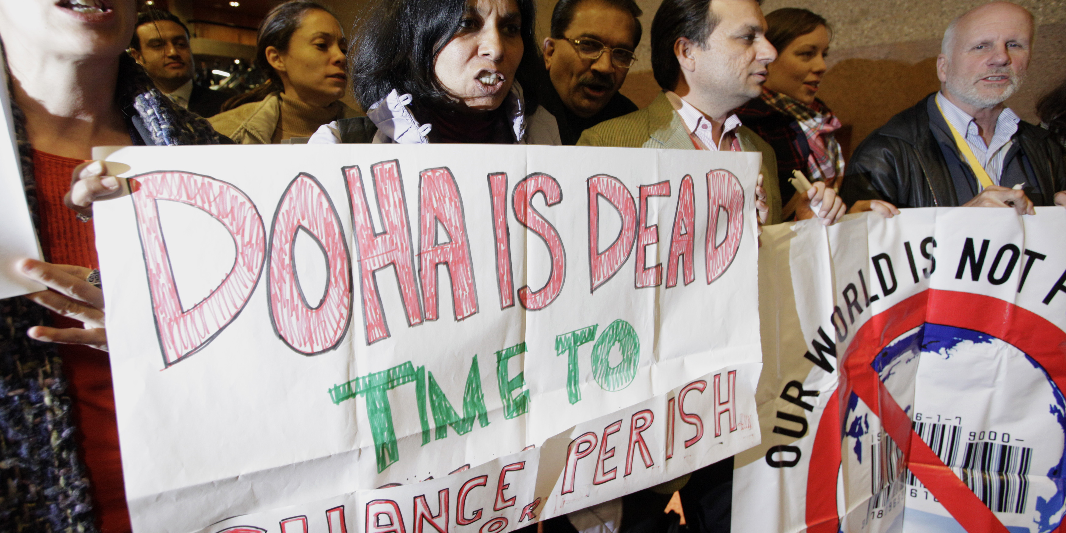 Activists of various nongovernmental organizations demonstrate against the Doha Round of global trade talks before the closing ceremony of the seventh WTO ministerial meeting in Geneva, on December 2, 2009.