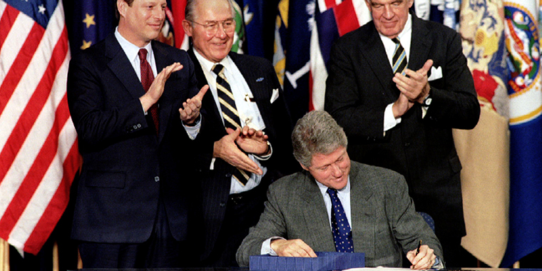 President Bill Clinton signs NAFTA into law, on December 8, 1993. The trade deal includes the diverse economies of the United States, Canada, and Mexico.